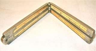 is a very nice Vintage Antique Bone Folding Rule Ruler 4 Fold 1 Foot