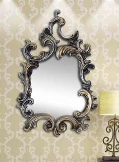 decorative mirror hangs near a lamp