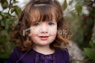 Happy Brown Haired Girl Smiling Outside Royalty Free Stock Photo